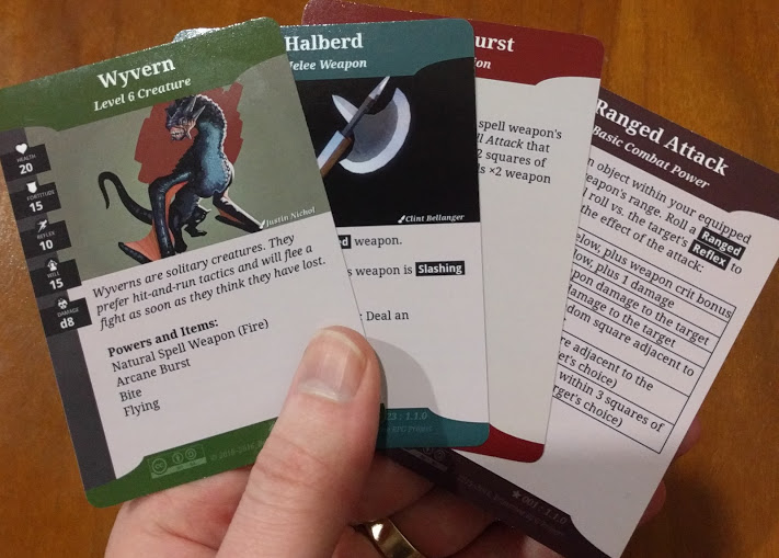 Tabletop game rules cards featuring Creative Commons art